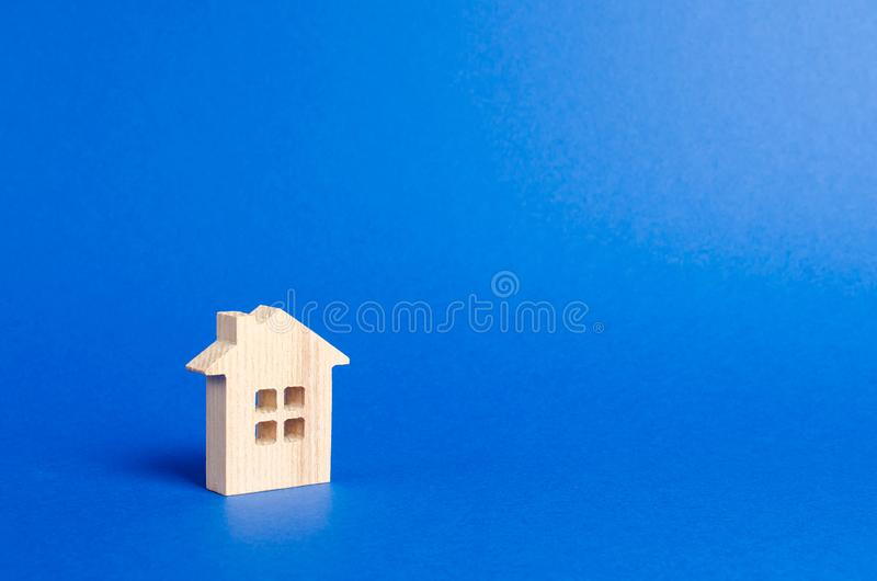 A small wooden house. concept of buying and selling real estate, renting. Search for a house. Affordable housing, credit and loans. Investments. Housing issues stock photo