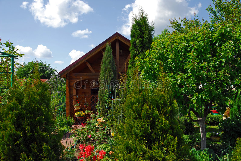Download Small Wooden House And The Garden Stock Photo - Image: 5154864