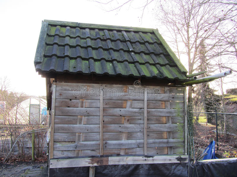 Small wooden house side view Netherlands stock photography
