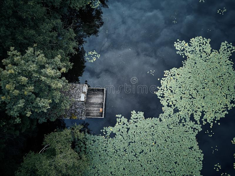 Small wooden house between trees and a lake. Germany royalty free stock image