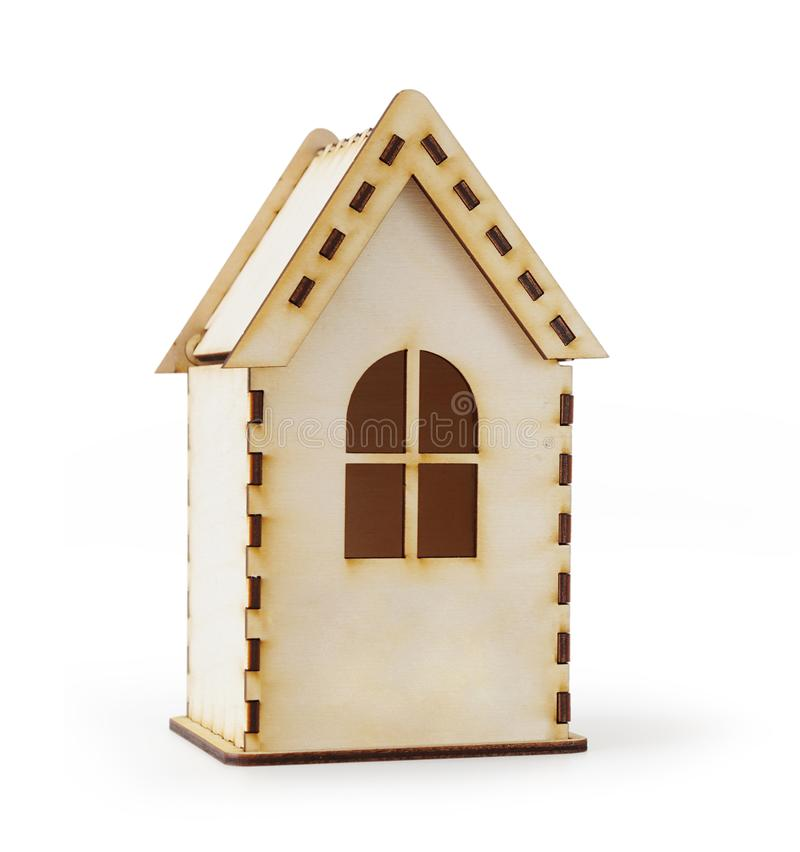 Small wooden model of a house isolated on white. Background stock photos