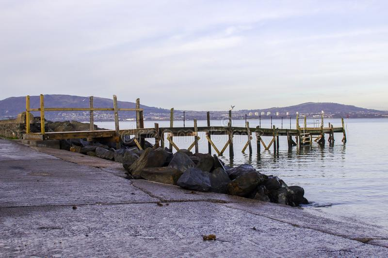 A small wooden pier on The Esplanade at Holywood County Down. A small wooden pier used by the local yaucht club on The Esplanade at Holywood County Down. Belfast royalty free stock photos