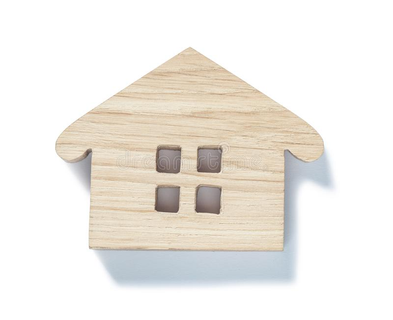 Small wooden toy wood house symbol isolated on white royalty free stock image