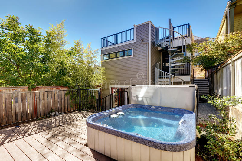 Small Wooden walkout deck with hot tub. House exterior. Wooden walkout deck with hot tub. House exterior in Tacoma. Northwest, USA royalty free stock images