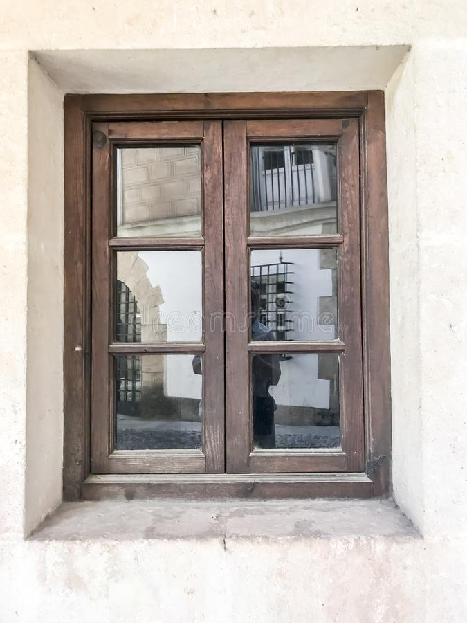 Small wooden window in historic building royalty free stock image
