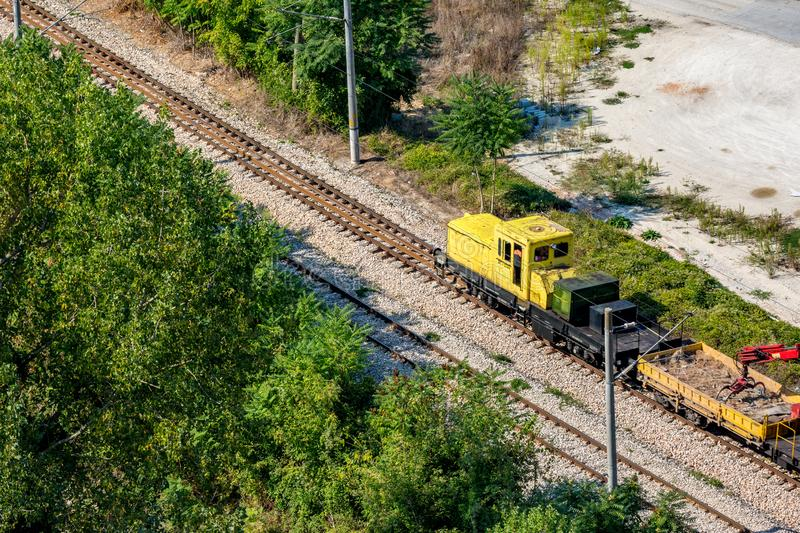 Small yellow railway service engine moving stock photography
