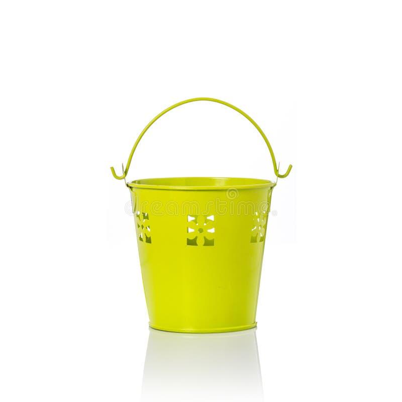 Small yellow vintage metal bucket. Studio shot isolated on white. Background royalty free stock photo