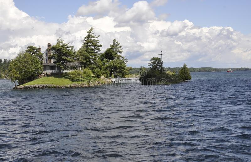 The Smallest Bridge between Canada and United States Border from Thousand Islands Archipelago. On 25 june 2017 royalty free stock photography