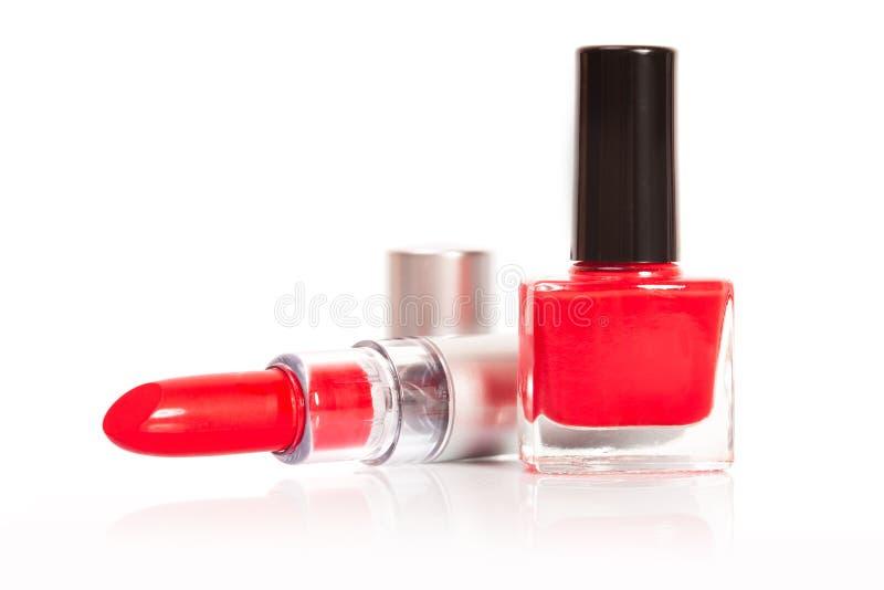Smalto rosso di chiodo e del rossetto fotografie stock