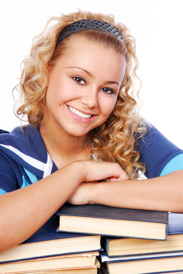 Smart adult girl. Portrait of smiling adult young girl journaled on the books royalty free stock photo