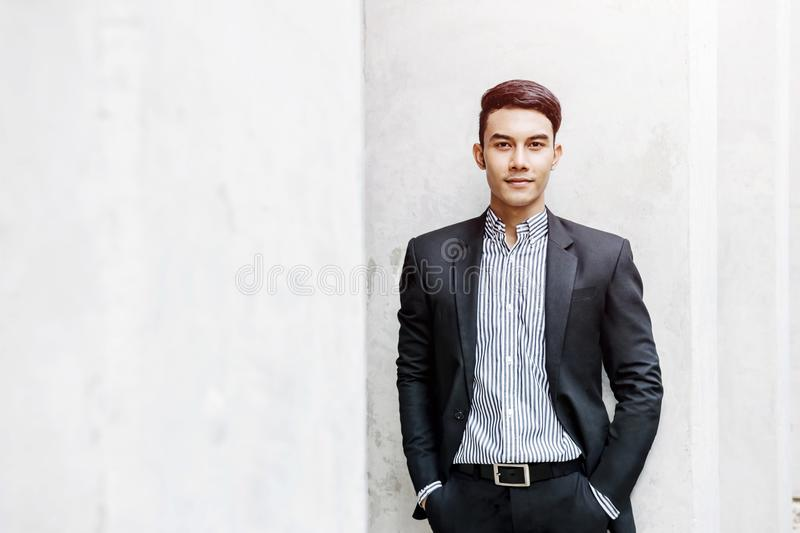 Smart Asian Businessman in Formal Suit, Looking at Camera and Sm royalty free stock photography