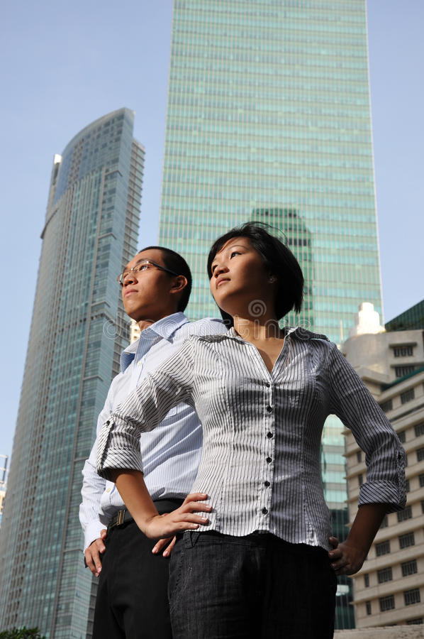 Smart Asian Couple with Office Building royalty free stock photos