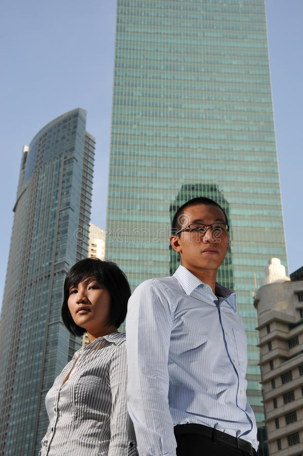 Smart Asian Couple with Office Building royalty free stock images