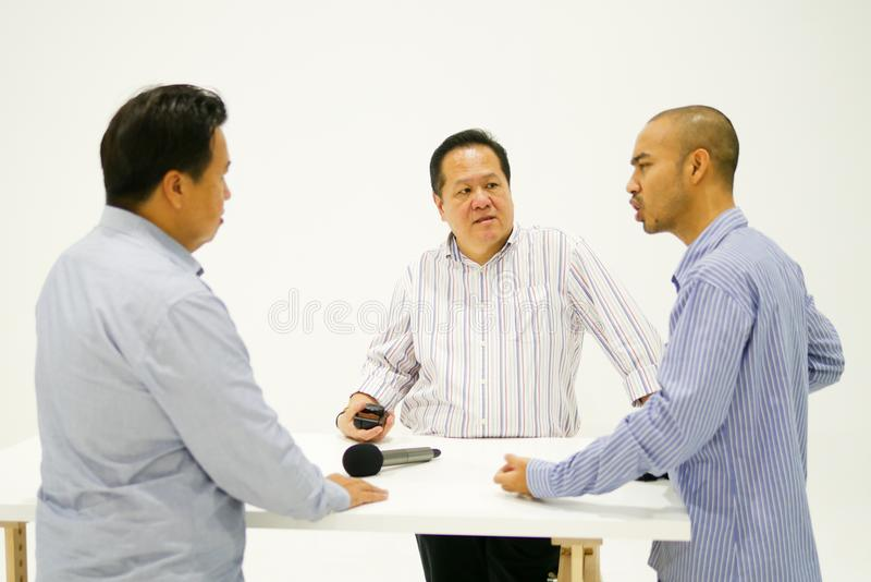 Smart Asian men are brainstorming about something royalty free stock images