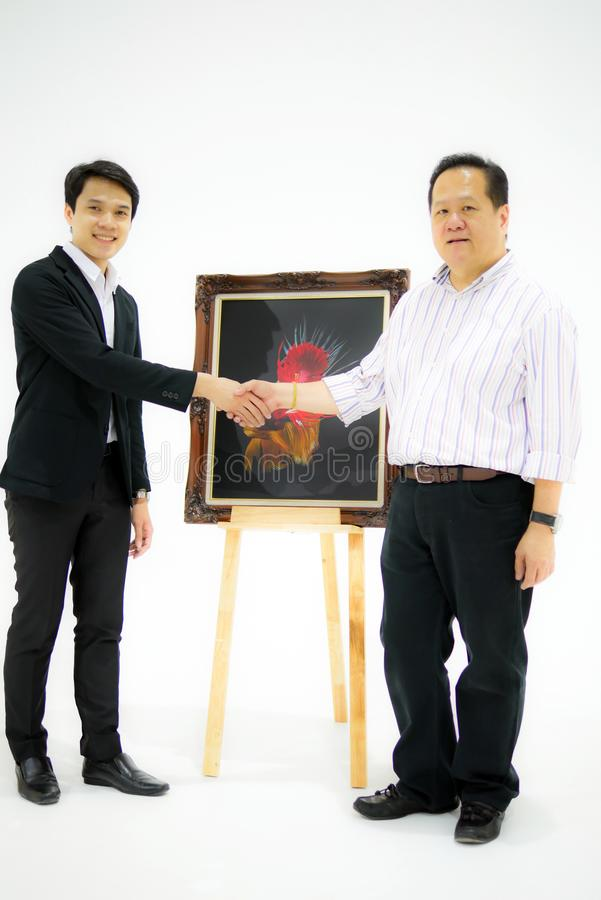 Smart Asian men is dealing with partner of selling the beautiful stock photos