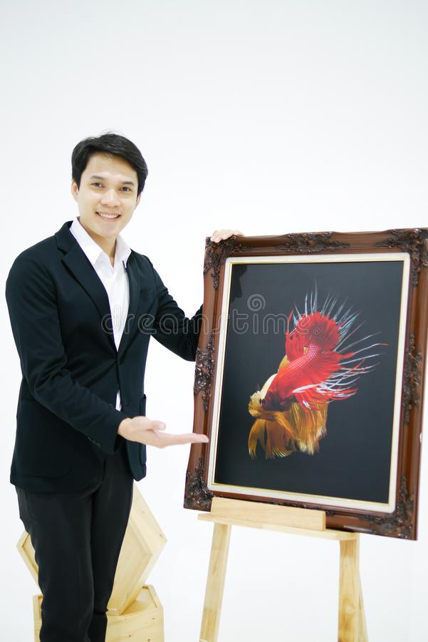 Smart Asian men is presenting the beautiful siamese fighting fis stock photo