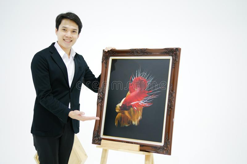 Smart Asian men is presenting the beautiful siamese fighting fis stock photos