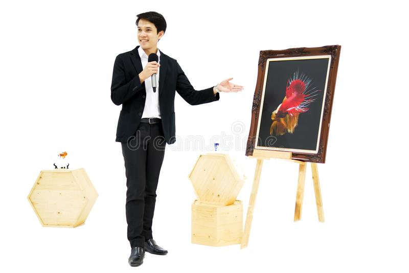 Smart Asian men is presenting the beautiful siamese fighting fish (betta) photo in the museum exhibition. stock images