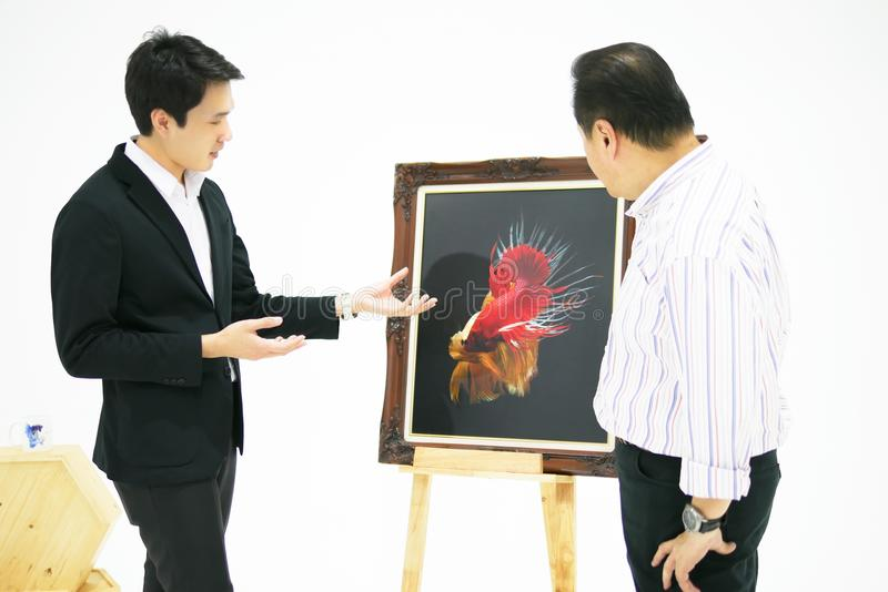 Smart Asian men is presenting the beautiful siamese fighting fis royalty free stock images