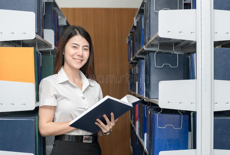 Smart asian student reading book in library university royalty free stock image