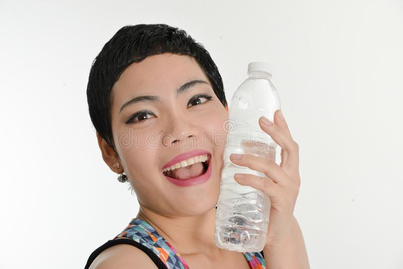 Smart Asian woman holding a bottle of water, healthy concept. stock photography
