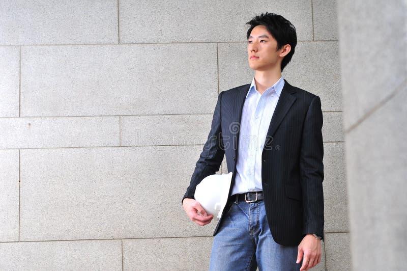 smart asiatisk tillfällig seende man royaltyfri fotografi