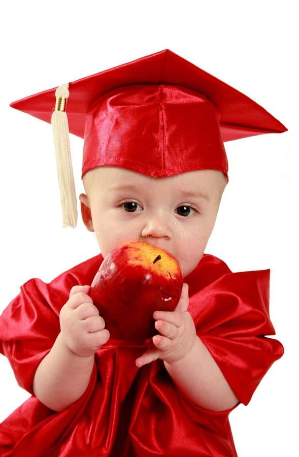 Smart baby. Little smart baby eating an apple