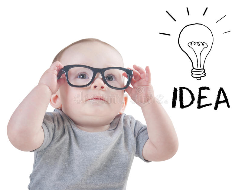 Smart baby with glasses has an idea royalty free stock photo