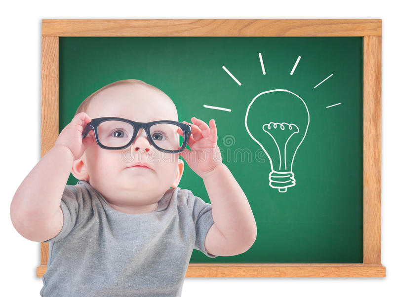 Smart baby with glasses and an idea royalty free stock photo