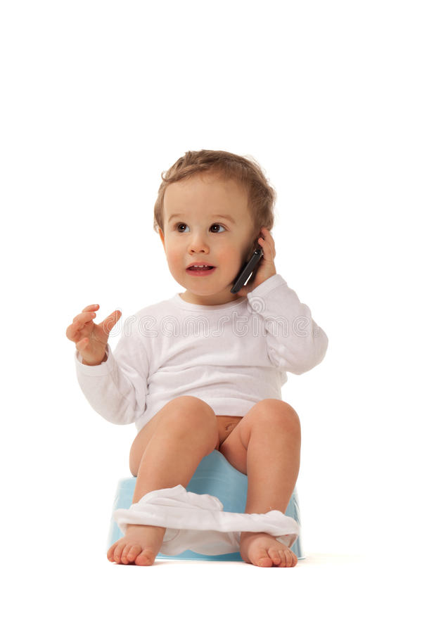 Smart boy. Boy sitting on a chamber bot playing with smartphone stock photos