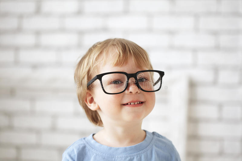 Smart boy with glasses. Indoors stock photo