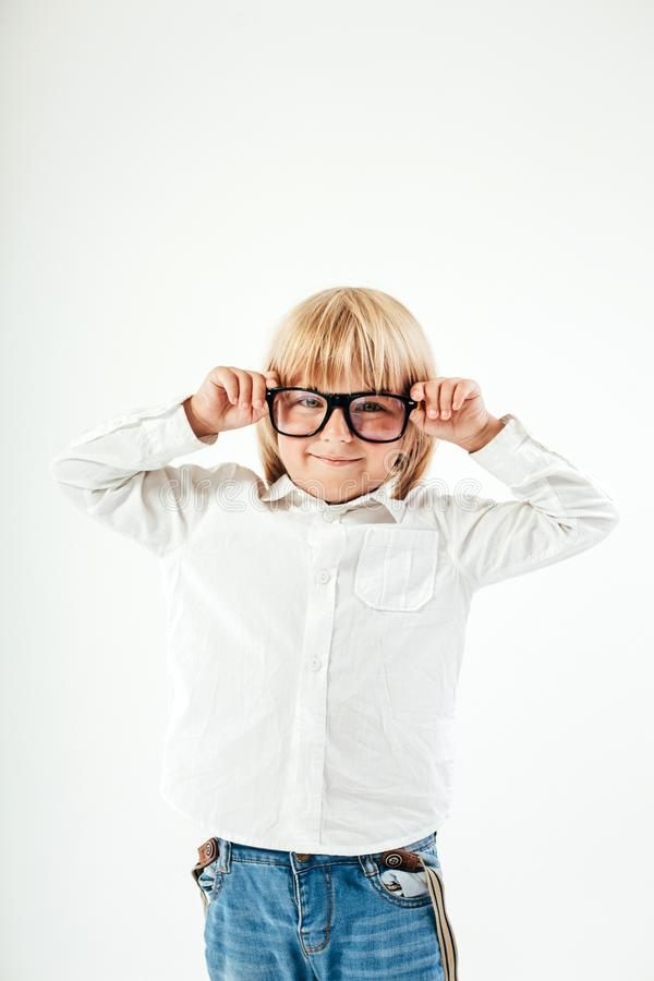 Smart boy is a graduate. Schoolboy with glasses.Education, isolated. School preschool. Education, isolated. Looking at camera. School concept. Back to School royalty free stock images