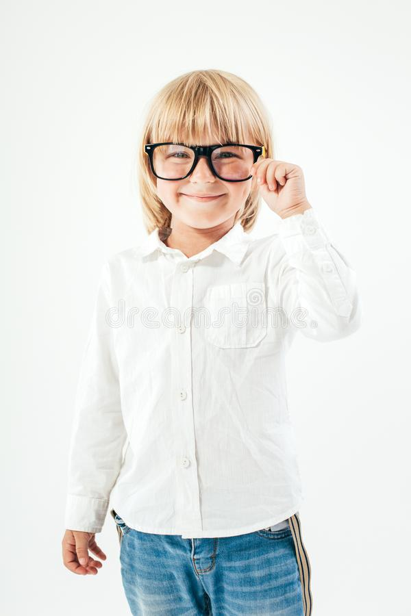 Smart boy is a graduate. Schoolboy with glasses.Education, isolated. School preschool. Education, isolated. Looking at camera. School concept. Back to School stock images