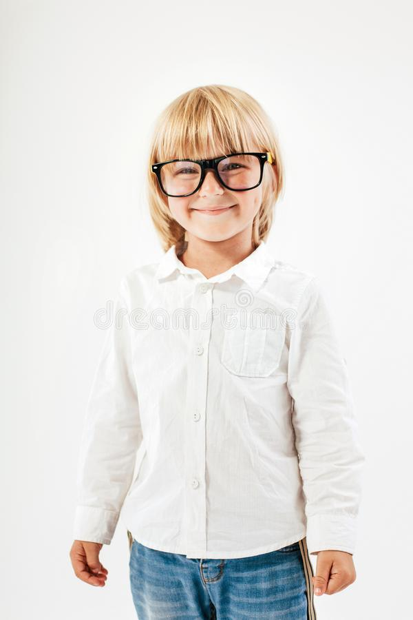 Smart boy is a graduate. Schoolboy with glasses.Education, isolated. School preschool. Education, isolated. Looking at camera. School concept. Back to School royalty free stock photos