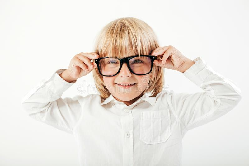 Smart boy is a graduate. Schoolboy with glasses.Education, isolated. School preschool. Education, isolated. Looking at camera. School concept. Back to School royalty free stock image