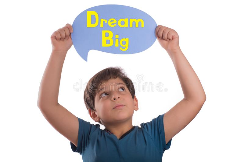 Dream big on thought bubble. A smart boy holding thought bubble top of head with dream big text , isolated on white background stock images