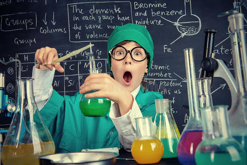 Unexpected chemical reaction. Smart boy scientist making chemical experiments in the laboratory. Educational concept. Discovery stock images