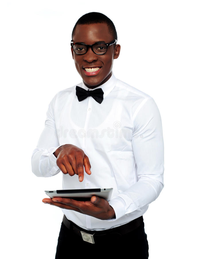 Smart boy using touch screen device royalty free stock images