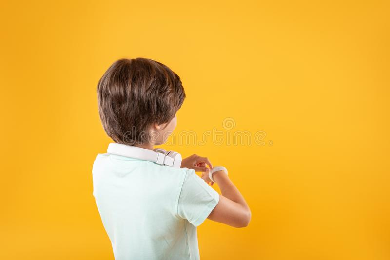 Smart boy wearing a modern watch royalty free stock photos