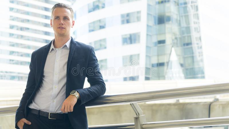 Smart business confident man stand at the outdoor public space royalty free stock images