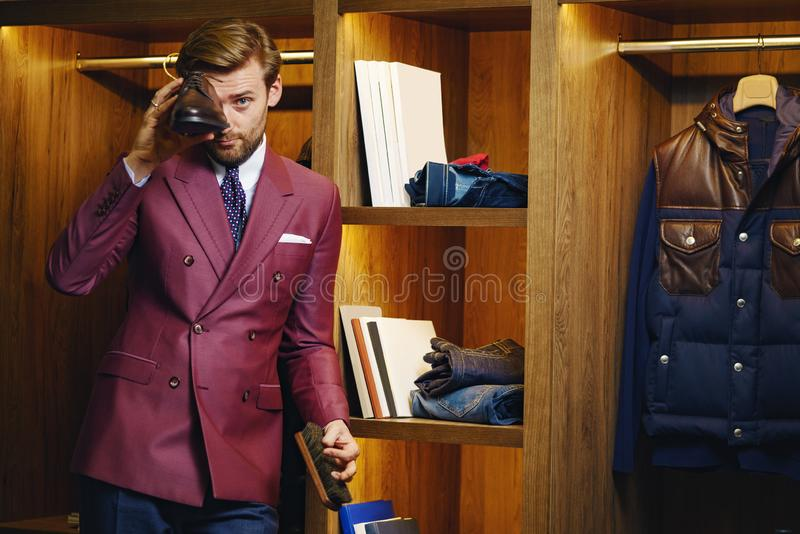 Smart business male in trendy showroom royalty free stock photography