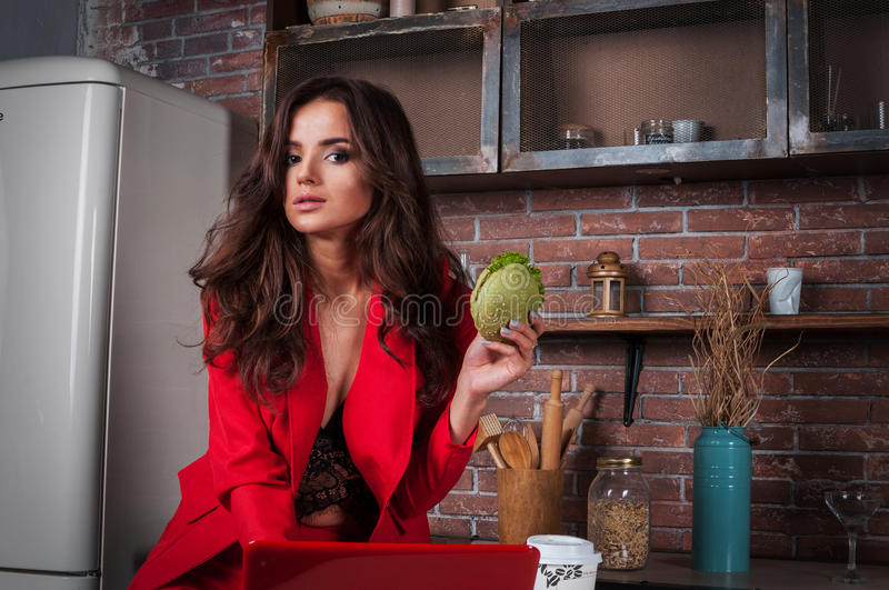 Smart business woman working on her laptop at home in kitchen. royalty free stock image
