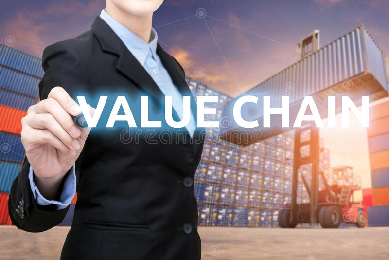 Smart business woman is writing value chain word stock photography