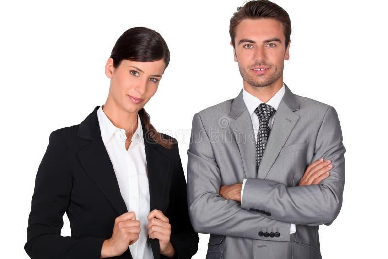 Smart businessman and businesswoman stock photos