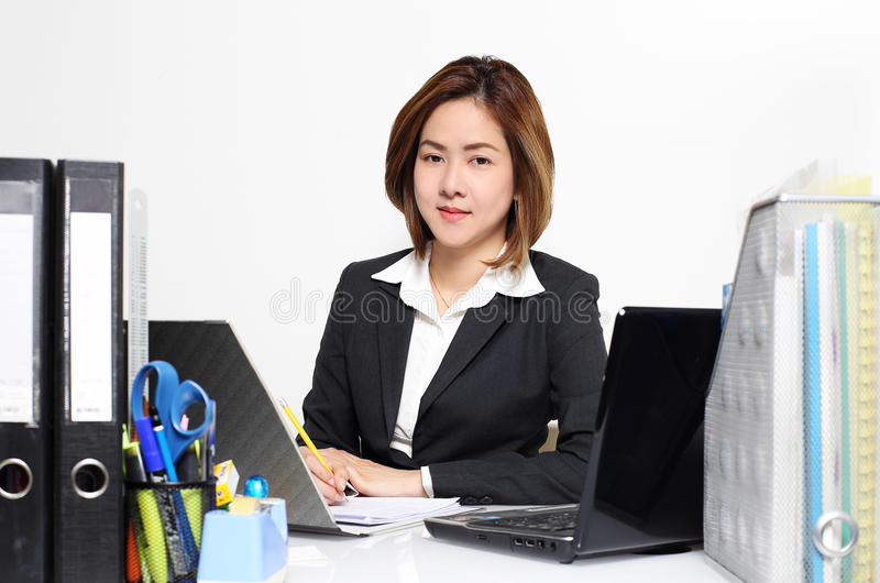 The smart businesswoman Asian working in office on the table royalty free stock photo