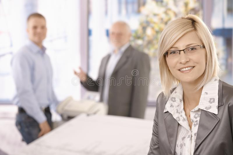 Smart Businesswoman In Office With Coworkers Stock Images
