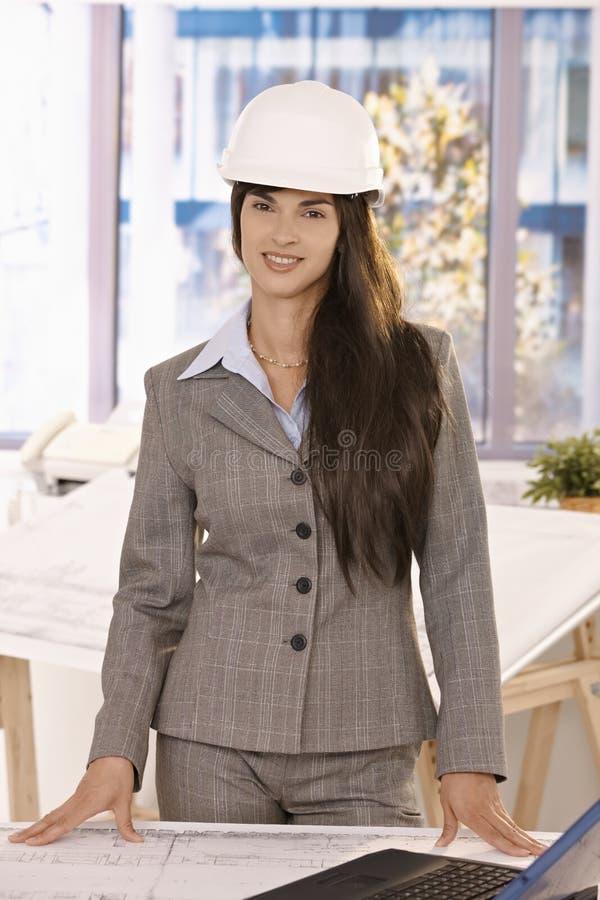 Download Smart Businesswoman Wearing Hardhat Smiling Stock Image - Image: 18489719