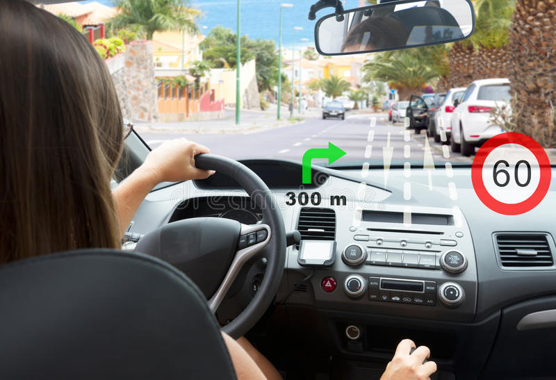 Smart car concept. Woman driving at country road with head up system shows road informaion stock photos