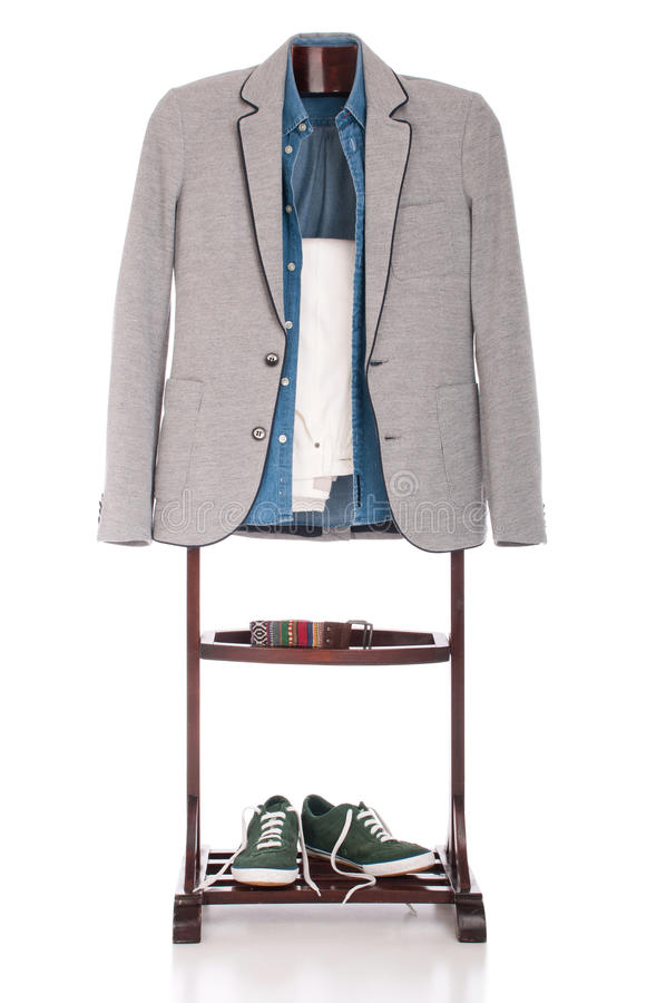 Smart casual clothing. Smart casual man dressing for a celebration, event, wedding or night-out on a wooden hanger (shirt, jacket, trousers, belt and stylish stock photo