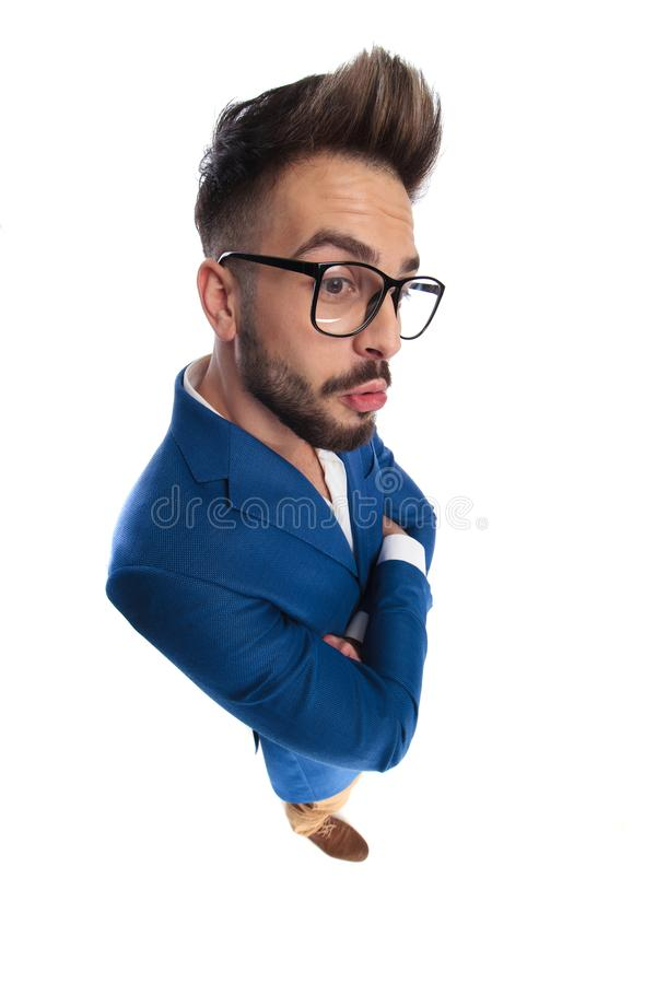 Smart casual man with arms folded is caught off guard royalty free stock image